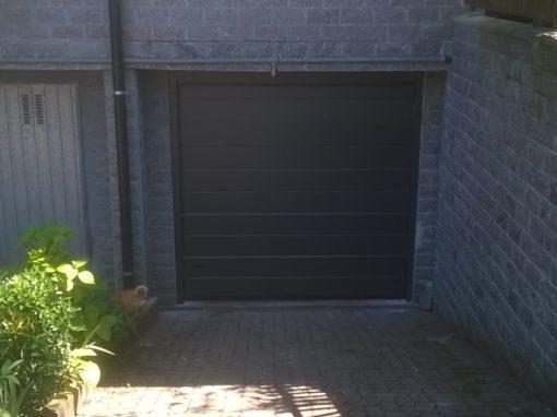 fornitura e posa porta sezionale completa automazione Faac